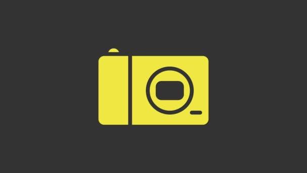 Žlutá ikona fotoaparátu izolované na šedém pozadí. Ikona fotoaparátu. Grafická animace pohybu videa 4K