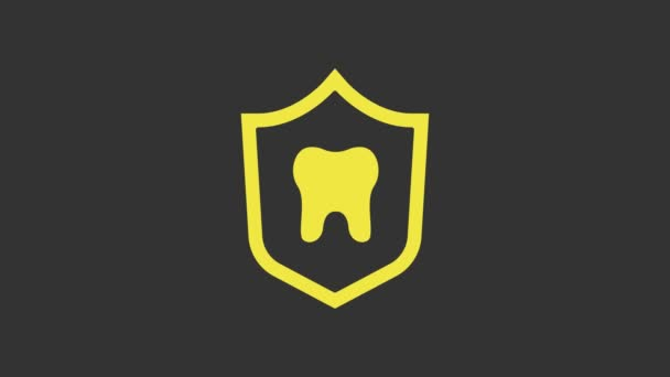 Yellow Dental protection icon isolated on grey background. Tooth on shield logo. 4K Video motion graphic animation