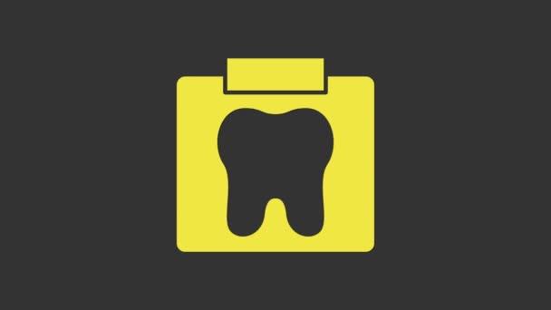 Gelbes Röntgenbild des Zahnsymbols isoliert auf grauem Hintergrund. Zahnröntgen. Bild der Radiologie. 4K Video Motion Grafik Animation