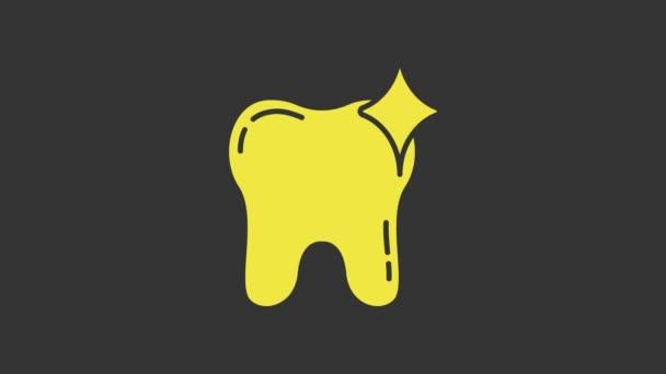 Gelbes Zahnweiß-Symbol auf grauem Hintergrund. Zahnsymbol für Zahnklinik oder Zahnarztpraxis. 4K Video Motion Grafik Animation