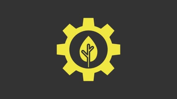 Yellow Leaf plant ecology in gear machine icon isolated on grey background. Eco friendly technology. World Environment day label. 4K Video motion graphic animation