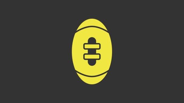 Sárga Amerikai futball ikon elszigetelt szürke háttér. Rögbi labda ikon. Csapat sport játék szimbólum. 4K Videó mozgás grafikus animáció