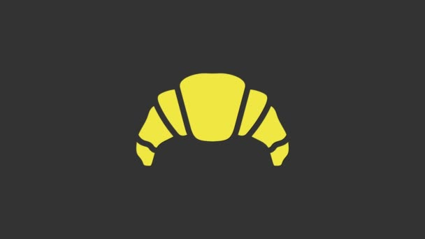 Yellow Croissant icon isolated on grey background. 4K Video motion graphic animation