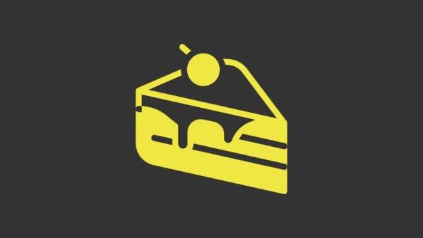 Sárga torta ikon elszigetelt szürke háttér. Boldog szülinapot! 4K Videó mozgás grafikus animáció