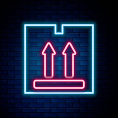Glowing neon line Cardboard box with traffic symbol icon isolated on brick wall background. Box, package, parcel sign. Delivery, transportation and shipping. Colorful outline concept. Vector icon
