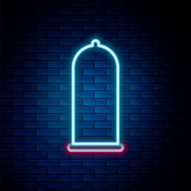 Glowing neon line Condom safe sex icon isolated on brick wall background. Safe love symbol. Contraceptive method for male. Colorful outline concept. Vector icon