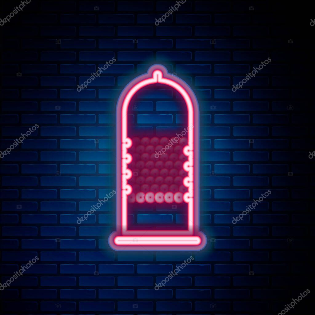 Glowing neon line Condom safe sex icon isolated on brick wall background icon