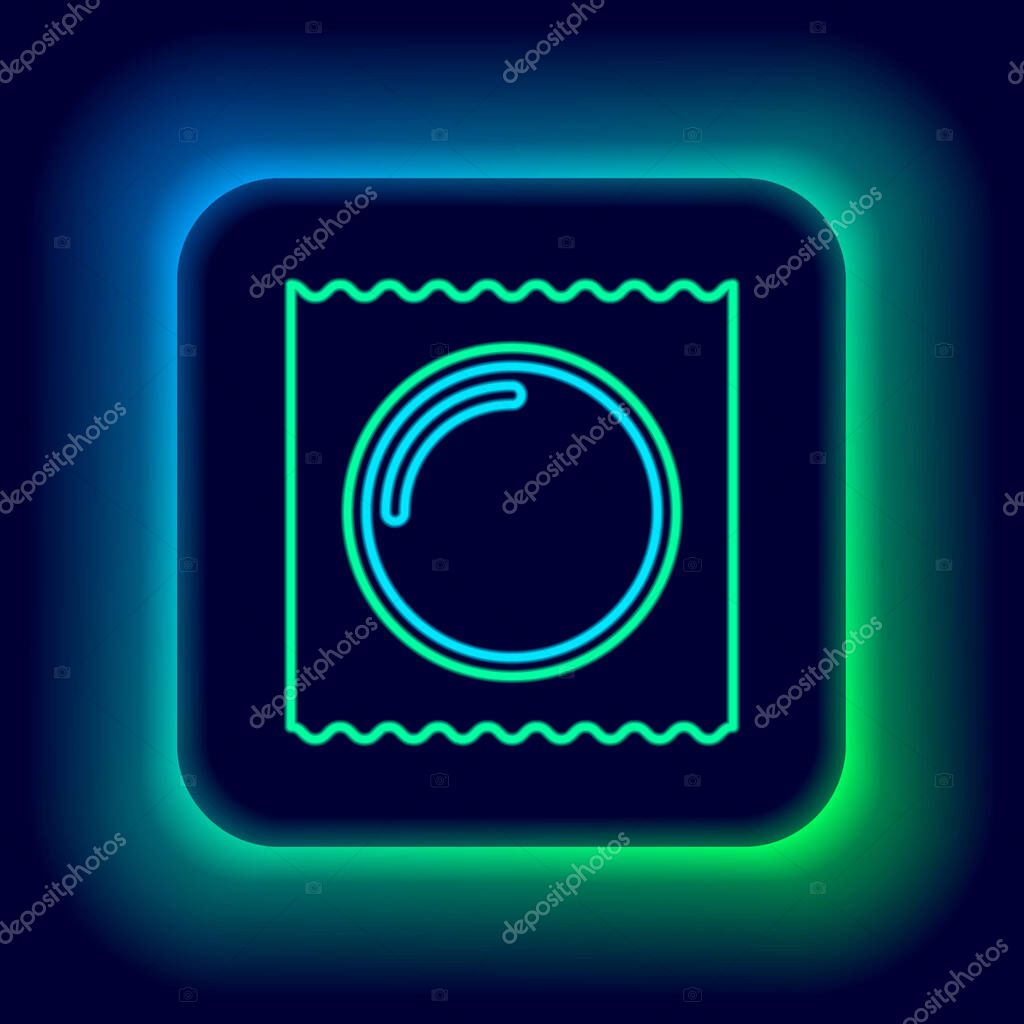 Glowing neon line Condom in package safe sex icon isolated on black background icon