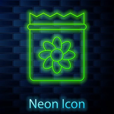 Glowing neon line Pack full of seeds of a specific plant icon isolated on brick wall background.  Vector icon