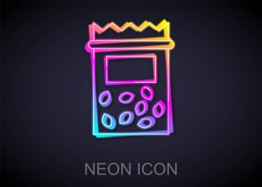 Glowing neon line Pack full of seeds of a specific plant icon isolated on black background.  Vector icon