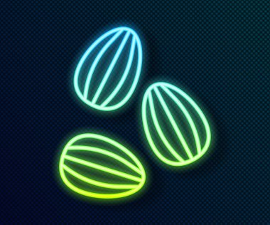 Glowing neon line Seeds of a specific plant icon isolated on black background.  Vector icon