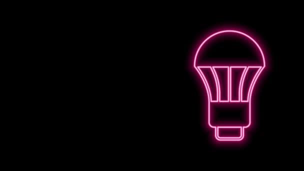 Zářící neonové vedení LED žárovka ikona izolované na černém pozadí. Ekonomická LED žárovka. Šetři si energii. Grafická animace pohybu videa 4K