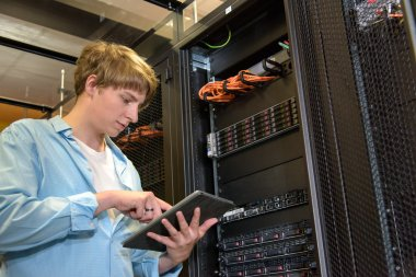 IT specialist configuring servers