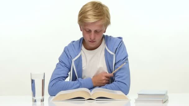 Teenager boy reading in white study book