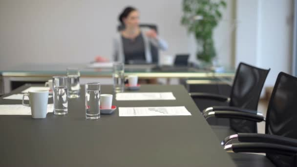 Office Meeting Room Table With Blurred Business Woman In Background Stock Video