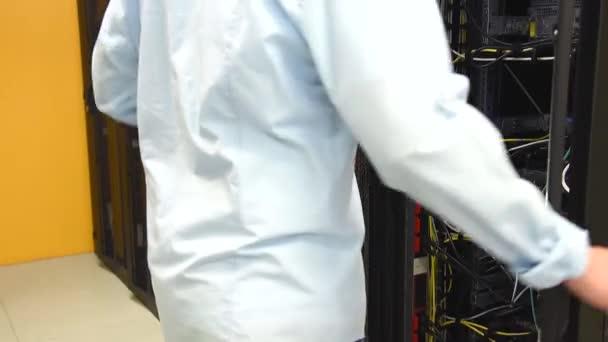 Datacenter administrator checking servers
