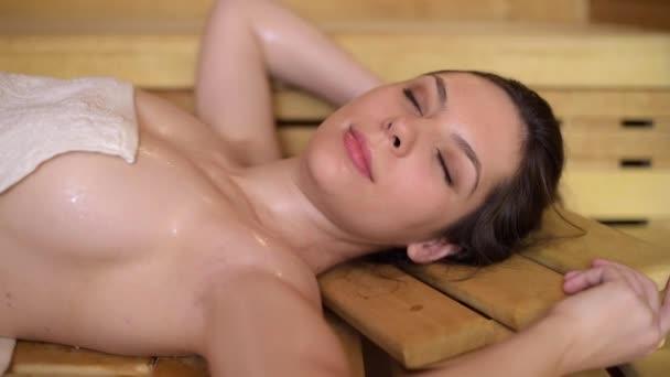 Woman resting in sauna