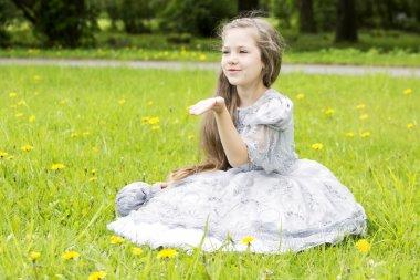 Romantic little child sends kisses through air