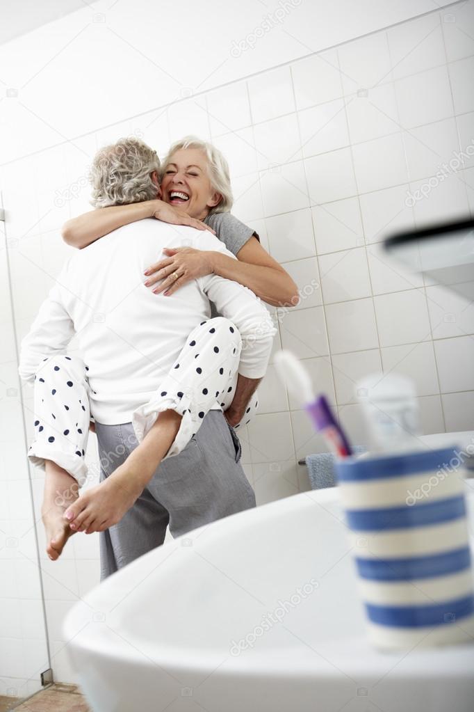 Romantic Senior Couple In Bathroom Stock Photo