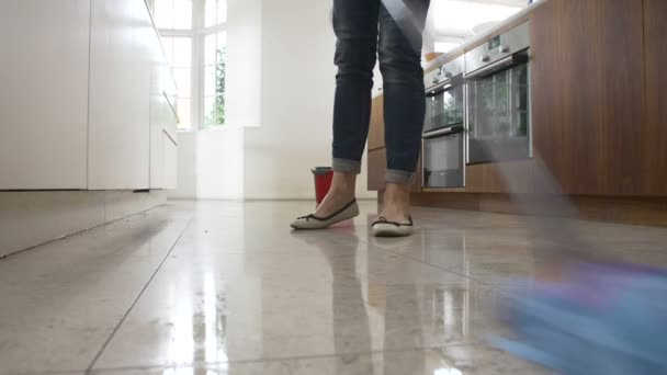 Woman cleaning Kitchen Floor — Stock Video © monkeybusiness #72119953