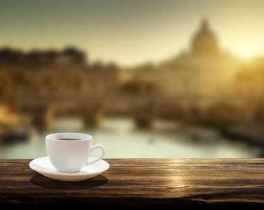 cup of coffee and St Peter Basilica in Vatican
