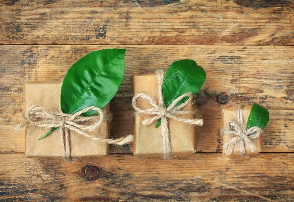 simple three gift boxes with green leaves