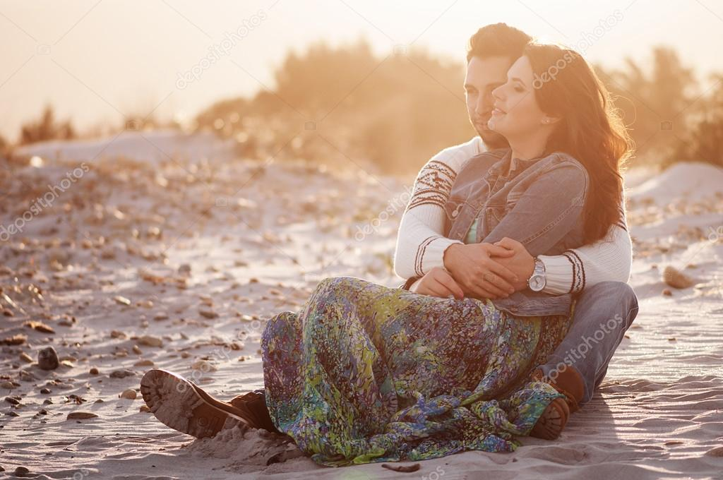Lovely young couple on beach