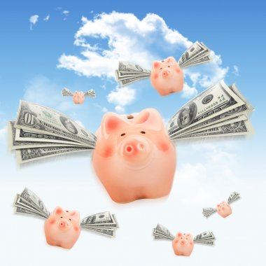 Pink piggy banks flying free in sky
