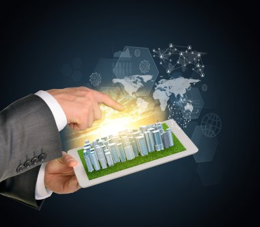 Man hands using tablet pc. Business city on touch screen. Virtual elements near computer