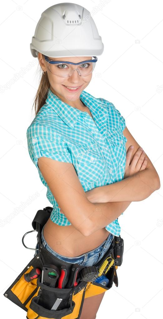 woman in hard hat tool belt and protective glasses stock photo