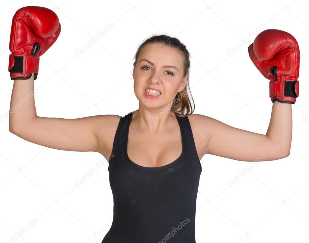 femme en gants de boxe posant avec ses bras vers le haut. Black Bedroom Furniture Sets. Home Design Ideas