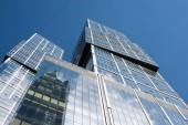 High-rise buildings on clear blue sky
