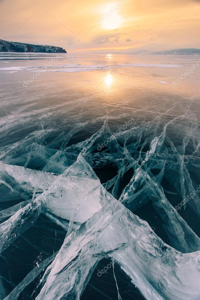 Cracks in the ice of Lake Baikal at sunset