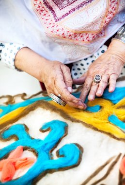 Kazakh woman making pattern