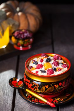 Russian porridge with pumpkin in hohloma dish