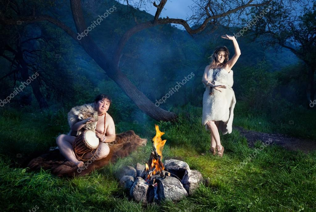 Cave people near bonfire