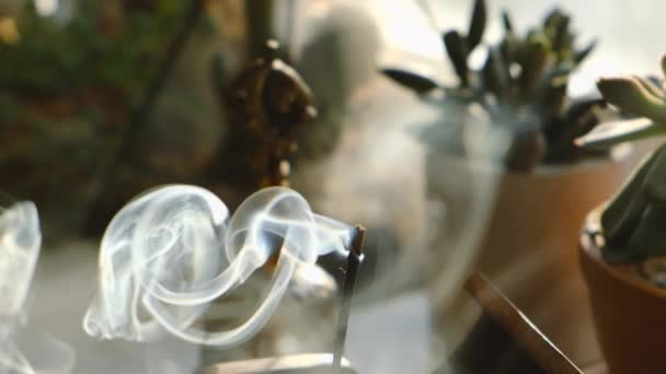 Incense stick smoke in slow motion close up