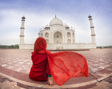 Woman in red near Taj Mahal