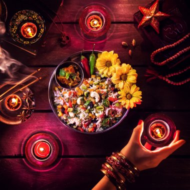 Vegetarian biryani, candles, incense and religious symbols at Diwali celebration on the table stock vector