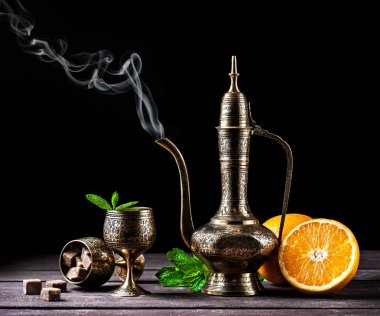 Hot Moroccan tea with mint and oranges