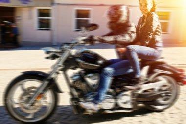 Biker riding motorbike
