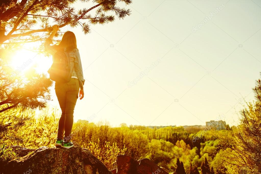 Woman mountain hiker with backpack enjoy view