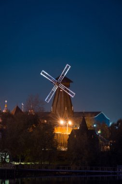 View on windmill Izmaylovo's Kremlin from Izmaylovskiy island in the night