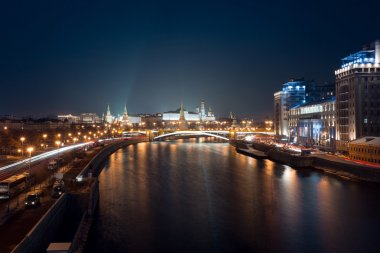 Night view on Moscow Kremlin towers, Moscow river, bridge, government buildings and Ivan the great bell tower