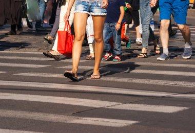 feet of the pedestrians on city street