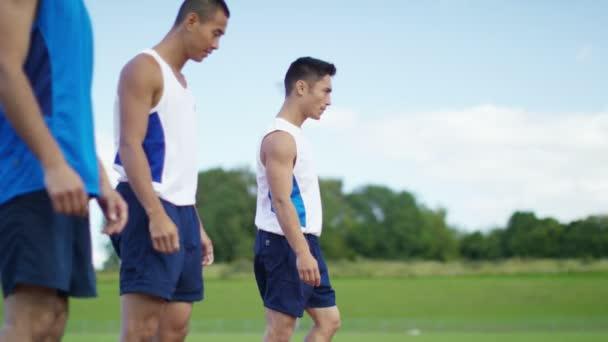 sportovci na běžecké dráhy