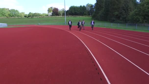 businessmen racing each other at running track
