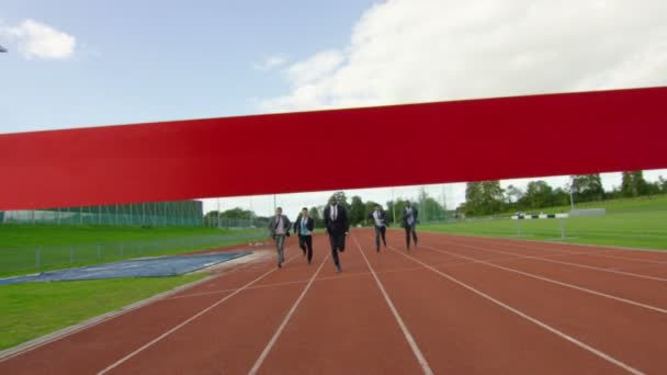 businessmen racing to the finishing line