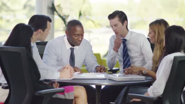 Business Group Discuss Ideas In Office Stock Video Hotelfoxtrot
