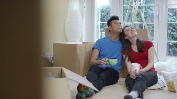 Take Break Coffeebreak : Couple take a coffee break from unpacking boxes u stock video